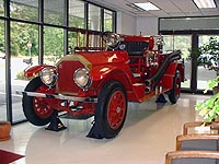 This is a picture of an old red fire truck